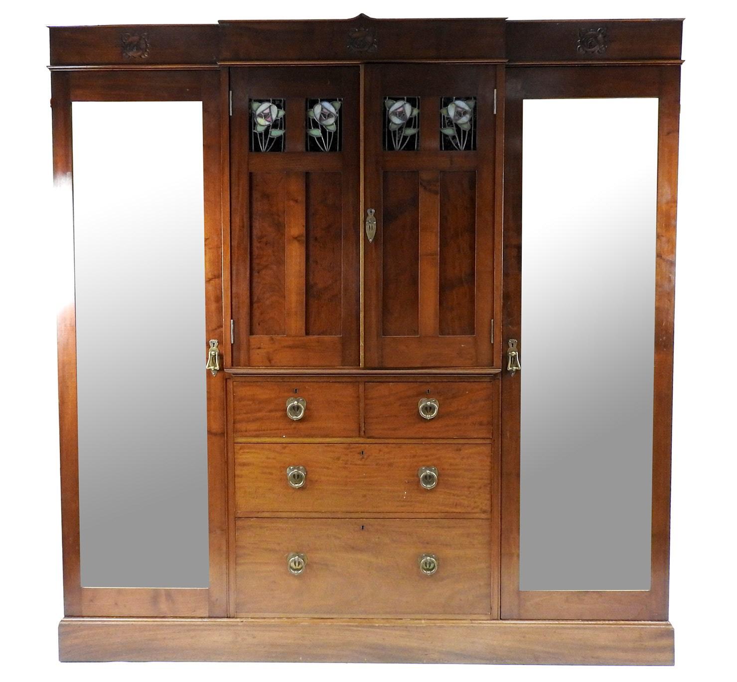 Lot 167, A Glasgow School Arts and Crafts mahogany bedroom suite