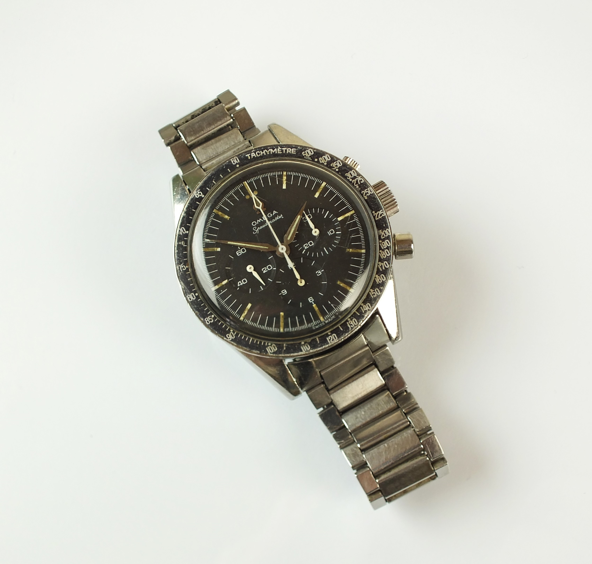 Lot 173 (The Autumn Auction, 16th September 2020)  An Omega Speedmaster wristwatch An Omega Speedmaster wristwatch, the black dial with luminous batons and three subsidiary dials, with black enamel tachymetre bezel, circa 1961, serial number 17-764-***, reference 2998-4, with attached Omega stainless steel bracelet  Sold for £8,200