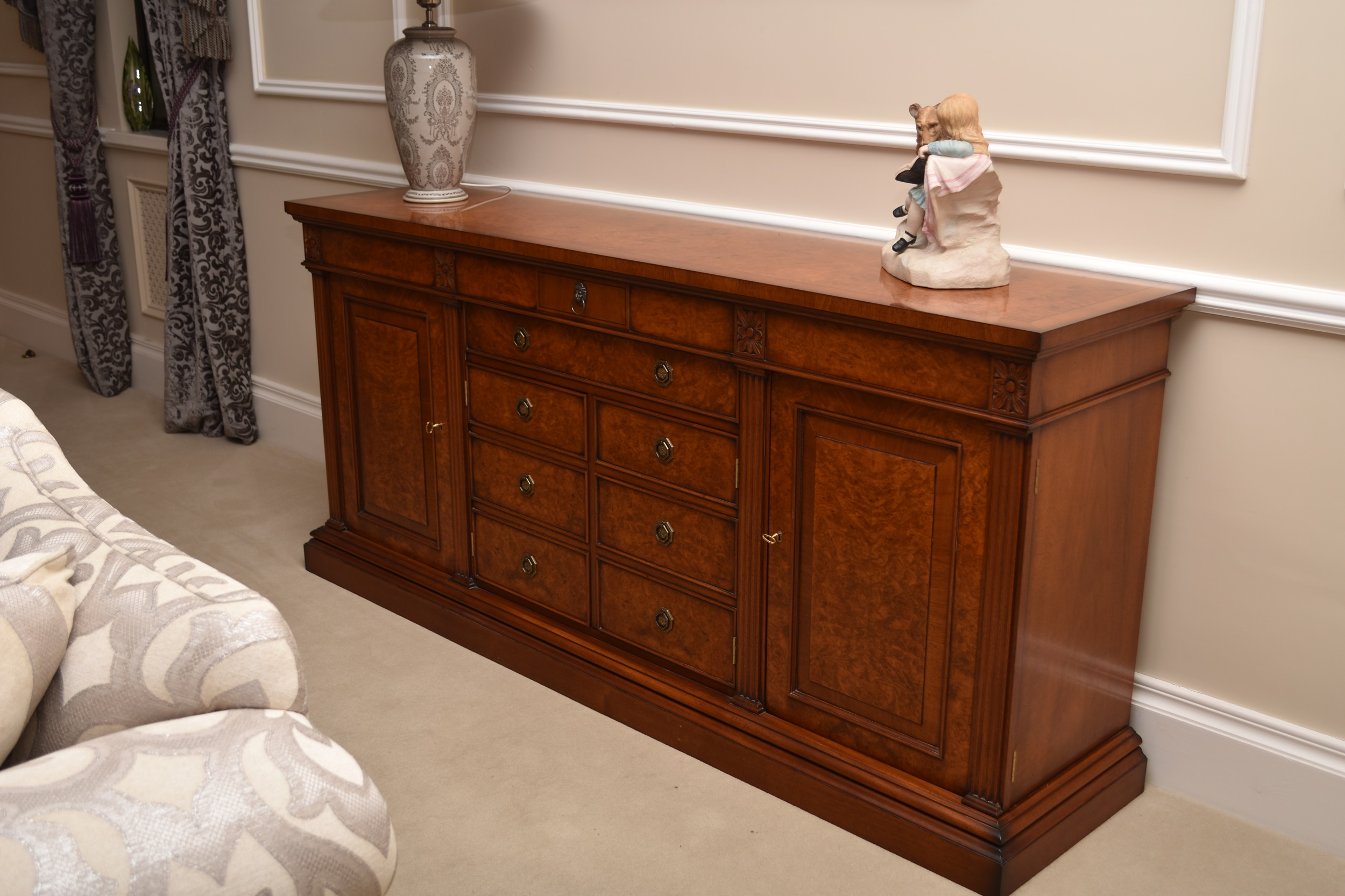 A Charles Barr burr walnut and mahogany veneered credenza-form sideboard