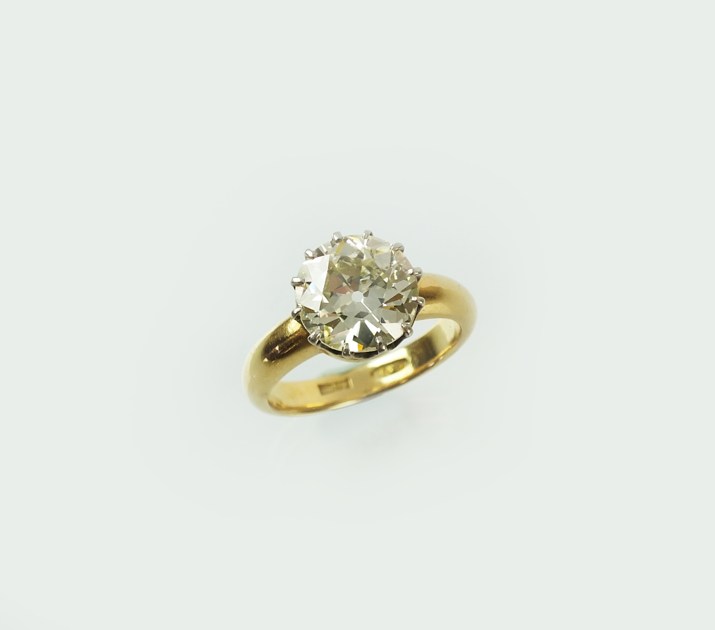 A single stone diamond ring, the brilliant cut diamond within twelve claw setting, mounted in white metal to yellow metal shank, stamped '18c', ring size R, the diamond weighs approx 4.10cts, colour estimated to be K/L, clarity estimated to be VS1-VS2, weight approx 8.1g  Sold for £13,500