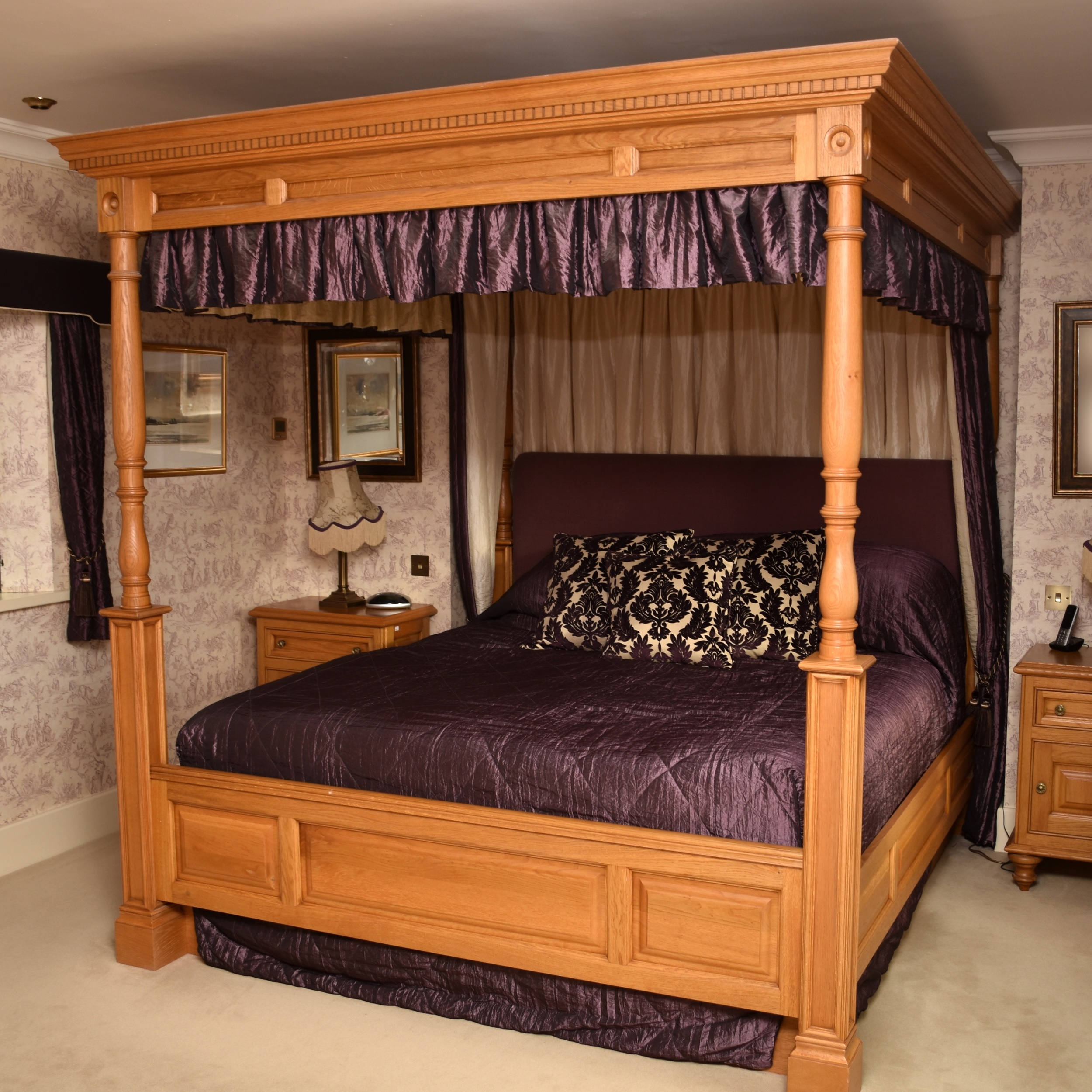 A recent and impressive Clive Christian light oak 'four-poster' bed, in the 18th century style