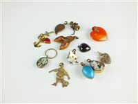 Lot 108 - A collection of twelve charms