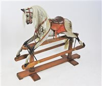 499 - A dappled grey rocking horse