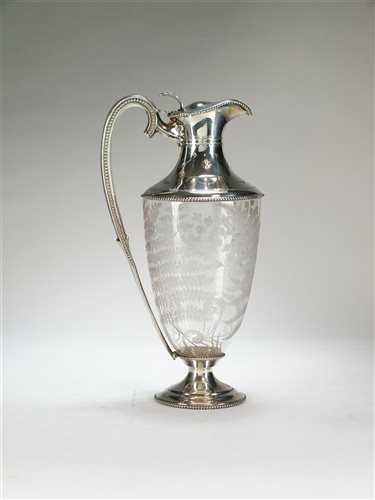Lot 55 - A silver mounted claret jug