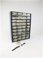 Lot 17-A thirty-six drawer cabinet with watch crystals