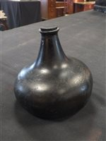 Lot 10-An 18th century glass onion bottle