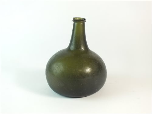 Lot 11-An 18th century glass onion bottle (chipped)