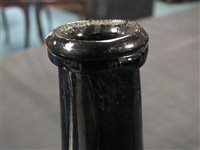 Lot 13-An 18th century green glass wine bottle with 'G.B' seal