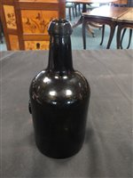 Lot 5-A glass wine bottle with 'John Winn Jr' seal