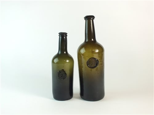 Lot 23-Two wine bottles with the Bagot family crest
