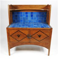 Lot 145-A late Victorian Scottish style oak and inlaid Arts and Crafts bedroom suite