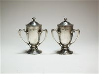 Lot 41-A pair of silver pepperettes