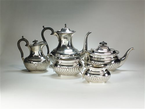 Lot 30-A five piece silver tea service