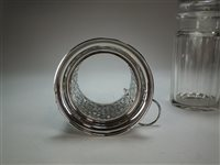 Lot 32-A silver mounted pickle jar and fork