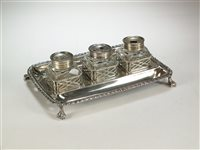 Lot 53-An early George III silver ink stand