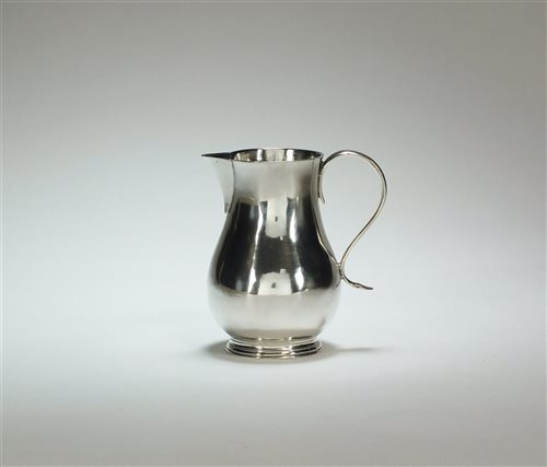 Lot 3-An early George II silver cream jug