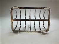 Lot 18-A George III silver toast rack