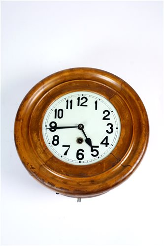 Lot 698-An early 20th century stained pine cased wall clock