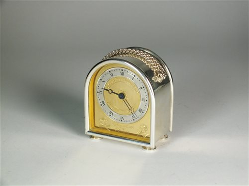 Lot 67-A silver commemorative Charles Frodsham carriage clock