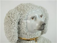 Lot 49-A pair of Continental porcelain shredded clay poodles