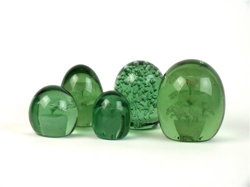 Lot 23-Five Victorian green glass dump paperweights