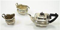 Lot 13-A three piece silver tea service