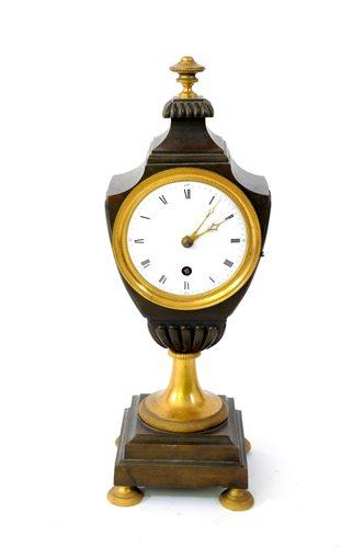 Lot 196-A bronze and ormolu classical urn shaped timepiece, Regency period