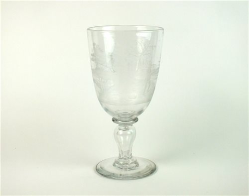 Lot 24-Fishing interest; a 19th century engraved glass goblet
