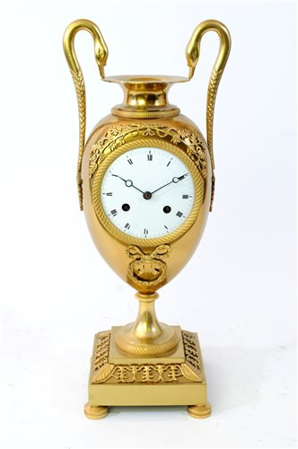 Lot 208-An Empire ormolu urn clock, early 19th century