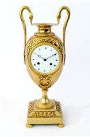 Lot 208-An Empire ormolu urn clock, early 19th century