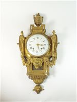 Lot 198 - A Louis XVI ormolu striking cartel clock