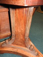 Lot 555-A Regency rosewood and satin wood crossbanded breakfast table