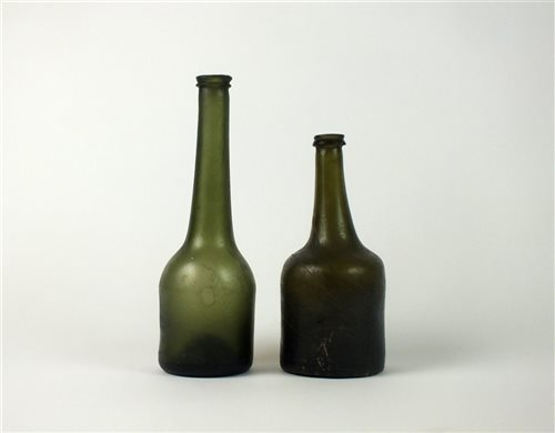Lot 5-Two 19th century green glass bottles