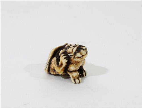 301 - A Japanese carved ivory tiger netsuke signed Hogen Rantei