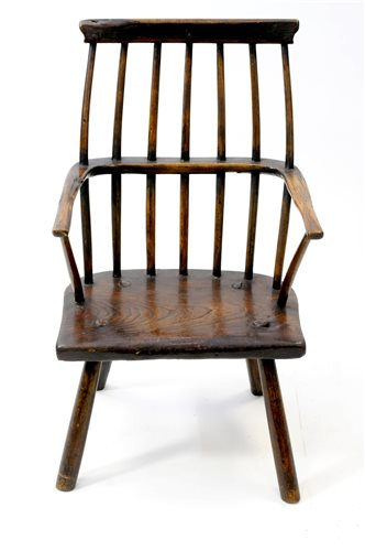 524 - An elm and ash vernacular stick back chair