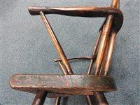 Lot 524 - An elm and ash vernacular stick back chair