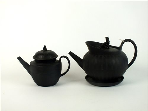 Lot 34-Two English black basalt teapots and covers