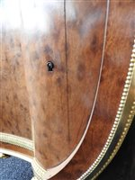 Lot 505-A French Louis XVI style marble top plum pudding mahogany ebony and ormolu mounted commode