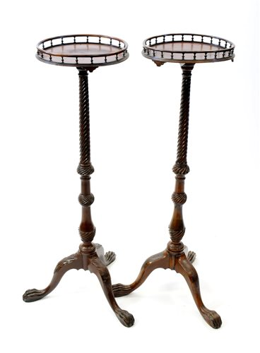 Lot 213-A near pair of George III style mahogany torchere stands