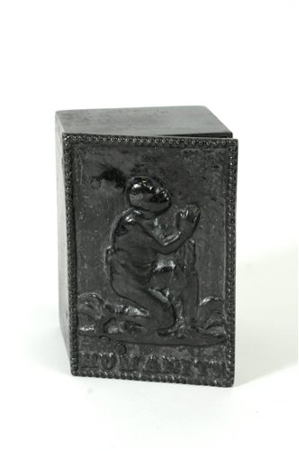 639 - In interest relating to the abolition of slavery, a cast iron tobacco box