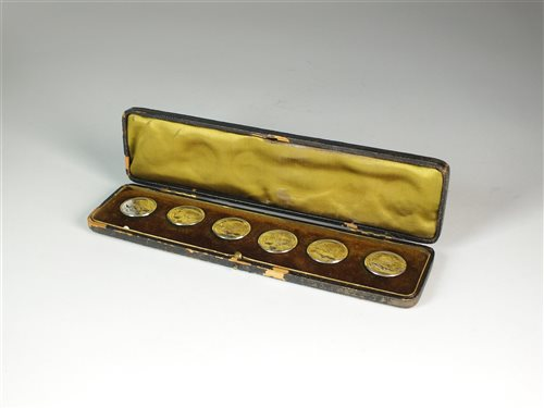 Lot 28-A cased set of silver Art Nouveau buttons