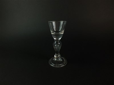 Lot 101 - A heavy baluster wine or dram glass, circa 1710