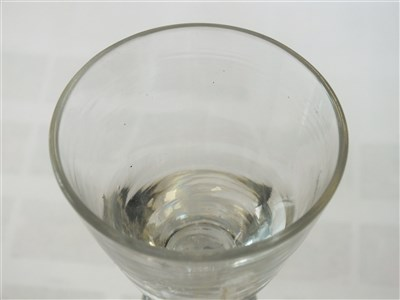 Lot 101-A heavy baluster wine or dram glass, circa 1710