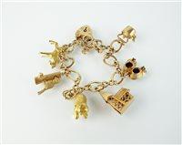 Lot 164-A 9ct gold charm bracelet