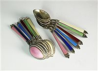 Lot 112-A set of American silver gilt and enamel spoons