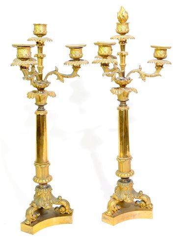 Lot 182-A pair of Charles X gilt bronze candlesticks