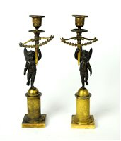 Lot 187-A pair of early 19th century Empire bronze and gilt candlesticks