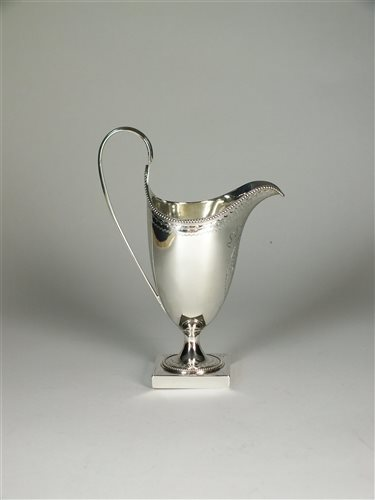 Lot 86 - A helmet silver cream jug