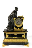 Lot 204-A French bronze ormolu and black marble mantel clock