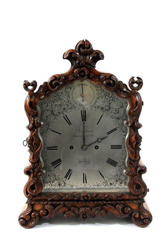 476 - Frodsham; an oak cased bracket clock